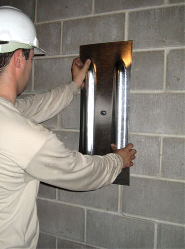 mounting a foundation wall plate for an earth anchor installation in